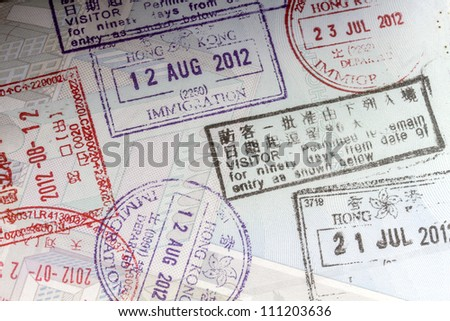 Background of passport stamps closeup - stock photo