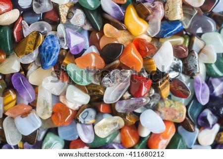 Background of polished colored gemstones - stock photo