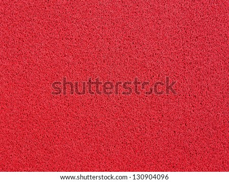 Background of red carpet or foot scraper - stock photo