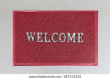 background of red welcome carpet - stock photo