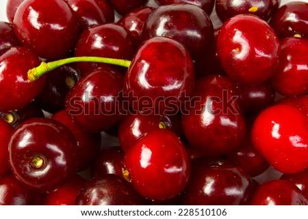 Background of ripe cherries in the farmer market  - stock photo