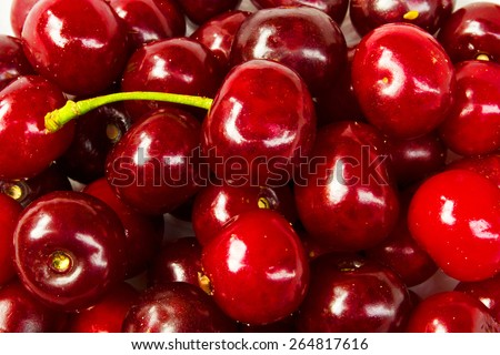 Background of ripe cherries in the farmer market  - stock photo