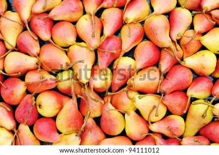 Background of ripe red pears. Juicy pears - top view. - stock photo