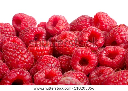 Background of ripe red raspberries. Isolated on white - stock photo