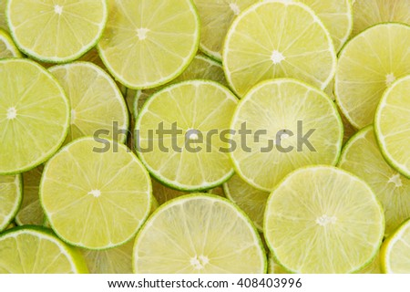 Background of ripe sliced limes - stock photo