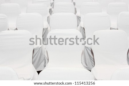 background of row of white seats - stock photo