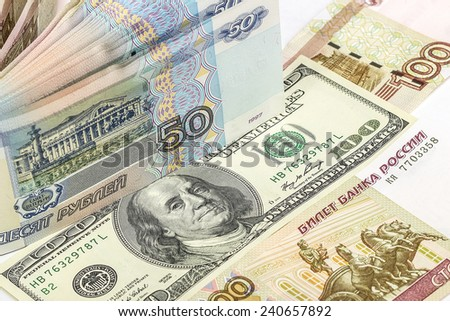 Background of Russian and American banknotes: pyatdesya and a hundred rubles, a hundred dollars