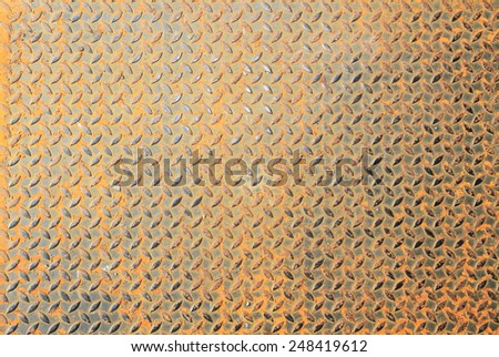 Background of rusty metal diamond plate - stock photo
