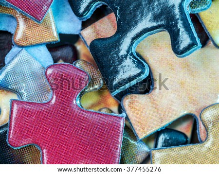 Background of scattered colorful puzzle pieces - stock photo