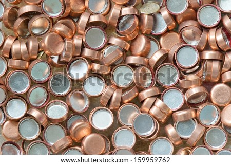 background of scattered copper hunting primers - stock photo