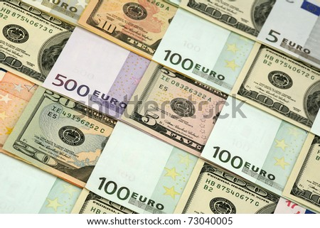 Background of several denominations - euro and dollars - stock photo
