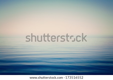 Background of sky and sea, sea is very calm with gentle ripples, instagram effect. - stock photo