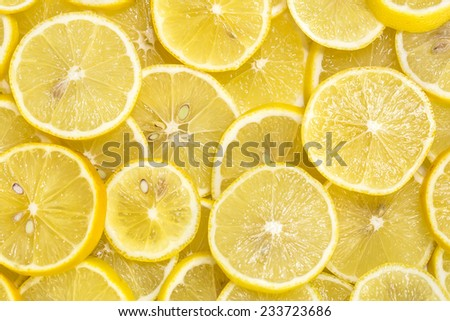 background of sliced ripe lemons - stock photo