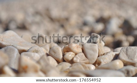 Background of small brown rocks. Shallow DOF