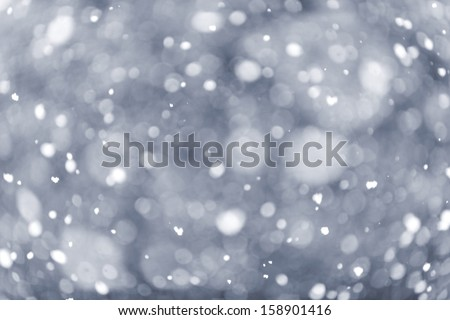 Background of snow flurry falling in winter with some motion blur - stock photo