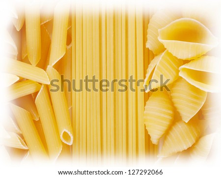 Background of spaghetti twisted and straight raw pasta