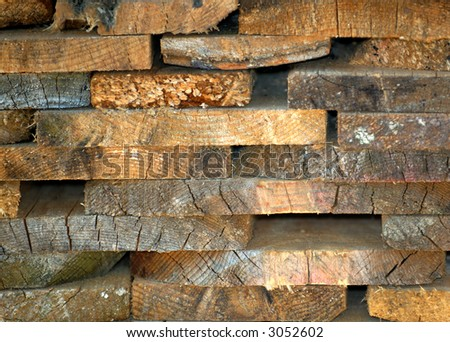 Background of stacked rectangular section wood panels.