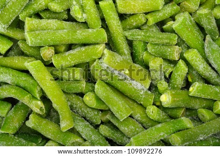 Background of the cut frozen green beans - stock photo