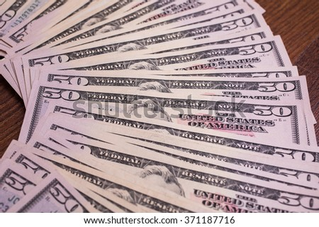background of the money, fifty dollar bills front side face. background of dollars,  millionaire, businessman - stock photo