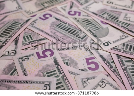 background of the money, five dollar bills down back reverse side . background of dollars, close up - stock photo