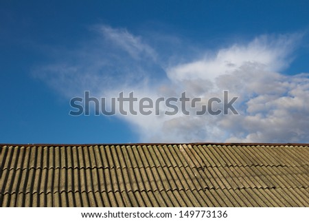 background of the roof and the sky with clouds