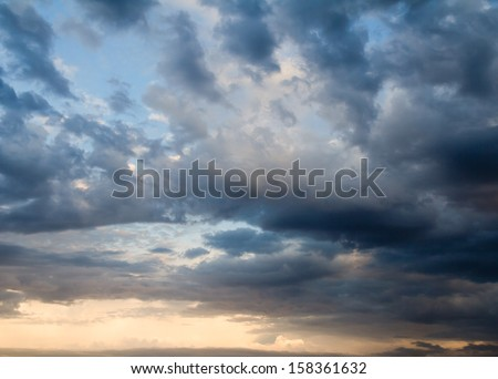 background of the sky with clouds at sunset - stock photo