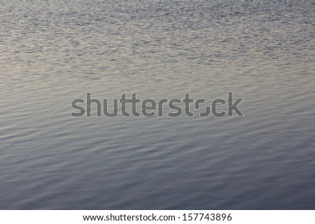 background of the surface of the lake water - stock photo