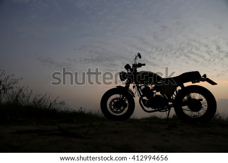 Background of vintage motorcycle in silhouette scene