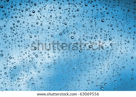 Background of water drops on a window glass in a rainy day - stock photo