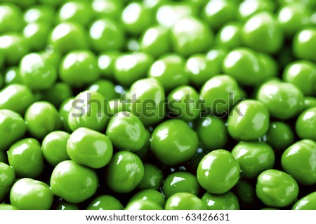 background of wet green peas - stock photo