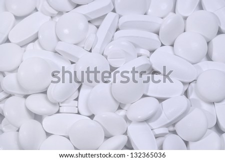 Background of white tablets and pills - stock photo