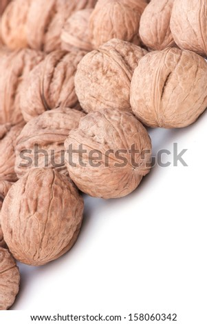 background of whole walnuts in shell - stock photo