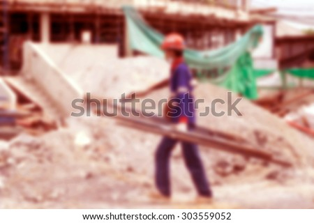 Background of worker at construcion site.
