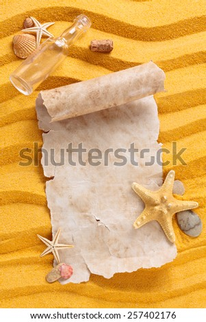 Background of   yellow  sand, ancient blank paper, shells and starfishes.  - stock photo