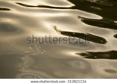 background of yellow surface of the water