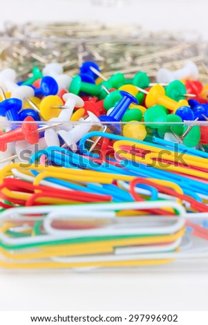 background office detail: staples and drawing pins - stock photo