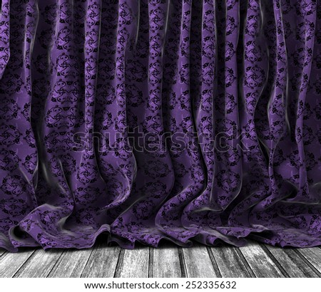 Background old vintage floral curtains in purple toned.Wood floor texture. - stock photo