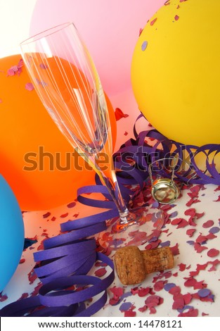 Background party with colorful balloons, glass, confetti and champagne cork