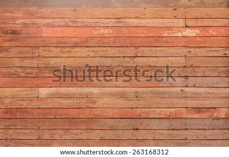 background pattern detail of old red wood strip texture on decorative  surface wall - stock photo