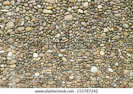 Background pattern of round smooth surface stone. - stock photo