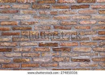 Background pattern of weathered old brick wall texture, grungy rusty brushed blocks as urban architecture backdrop. - stock photo