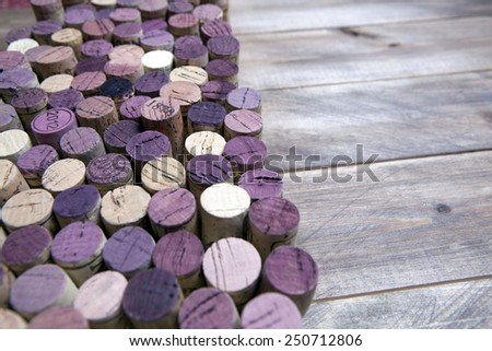 Background pattern of wine bottles corks on the wood - stock photo