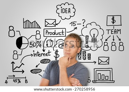 Background. Pensive young man with business plan concept - stock photo