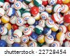 Background pile of many colored bingo balls - stock photo