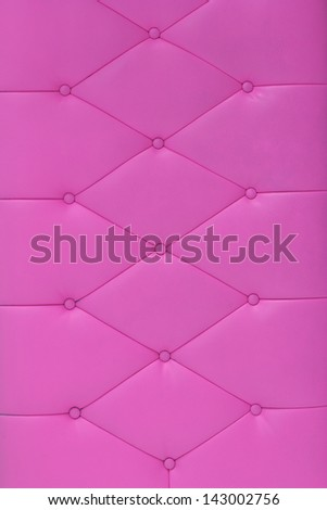 Background pink sofa. - stock photo