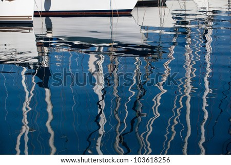 Background: reflection in a sea of yacht masts. - stock photo