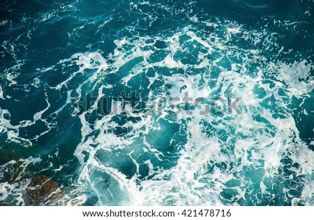 Background shot of clear sea water surface, close-up. - stock photo
