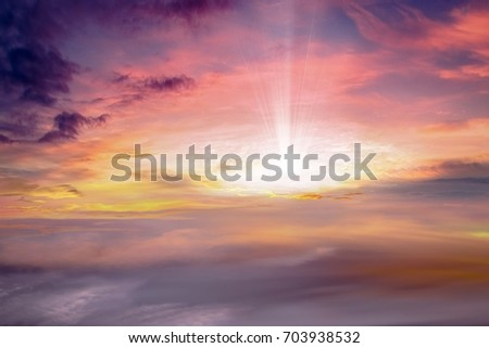 background sky at sunset and dawn . Glowing sunset . Sunset sky  .  Sunset or sunrise with clouds, light rays and other atmospheric effect . beam of the sun