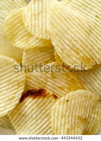 Background snack is sheet fried potatoes mellow yellow
