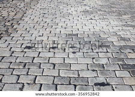 Background texture  cobblestone urban road